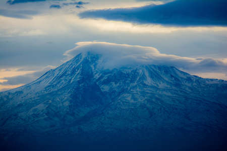 The top of Mount Ararat is covered with snow and clouds