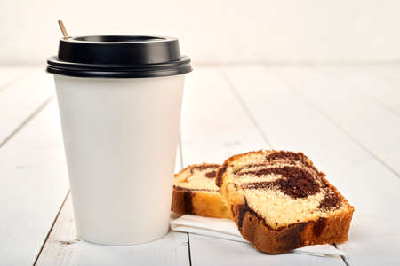 Coffee cup with pound cake on a wooden table