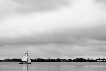 plassen: Small boat sailing on Langeraarsche Plassen, Netherlands Stock Photo