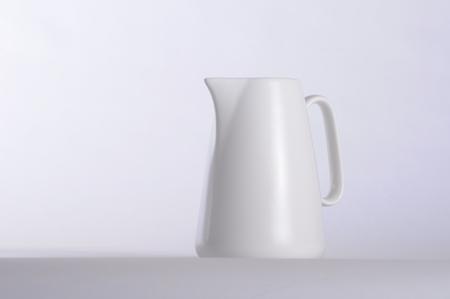 White coffee mug and white background.
