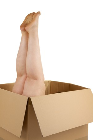 A woman�s legs sticking out of a box photo