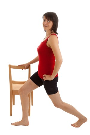 A young woman doing exercises with a chair