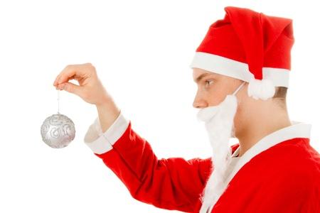Santa Claus with a Christmas tree ball Stock Photo - 8261802