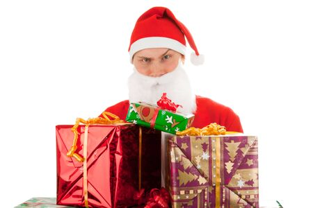 Santa Claus loaded with Christmas gifts Stock Photo - 8261804