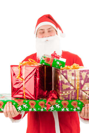 Santa Claus loaded with Christmas gifts Stock Photo - 8261825