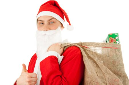 Santa Claus loaded with Christmas gifts Stock Photo - 8261823