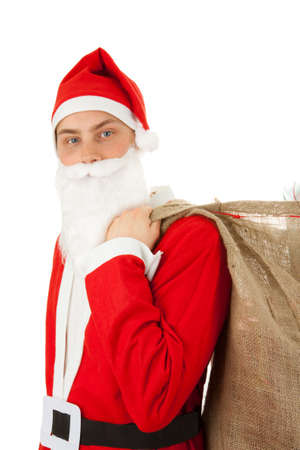 Santa Claus loaded with Christmas gifts Stock Photo - 8261830