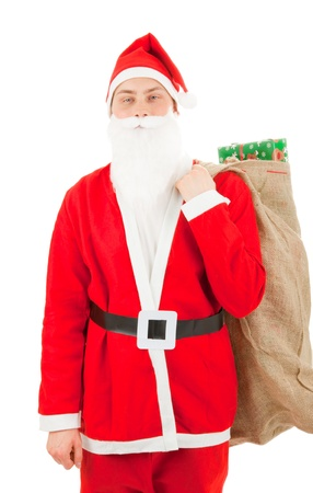 Santa Claus loaded with Christmas gifts Stock Photo - 8261822