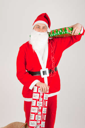 Santa Claus loaded with Christmas gifts Stock Photo - 8261824