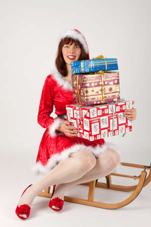 The Christmas woman with presents on her sled photo
