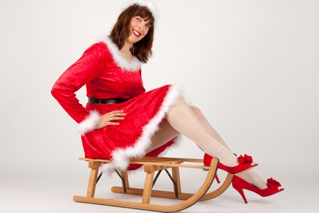 The Christmas woman on a her sled Stock Photo - 8261838