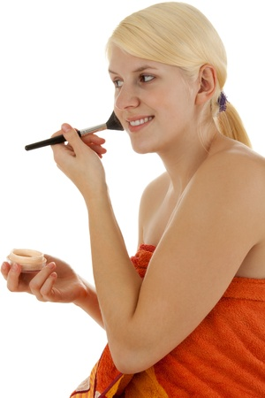 sexiness: A young girl powders her face