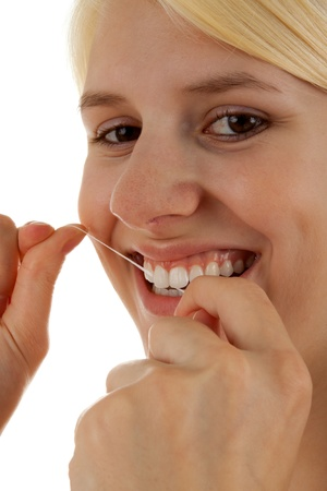 teeths: A young girl is brushing her teeths