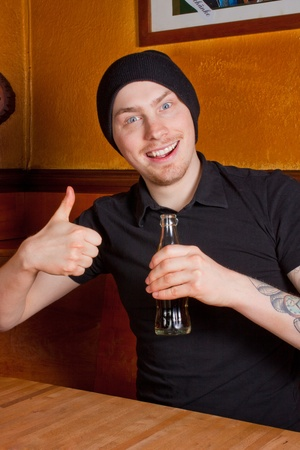 non alcoholic beer: A young guy with a drink in his hand