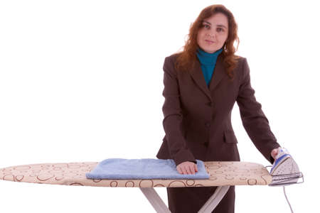 A young beautiful woman is ironing clothes photo
