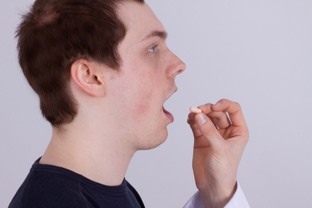 diagnostic findings: A young man gets drugs from his doctor Stock Photo