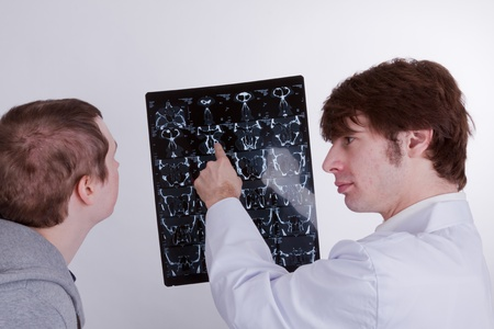 diagnostic findings: A doctor explains a young man his lungs problems