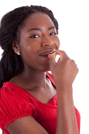 A young black woman is taking medicine Stock Photo - 9409489