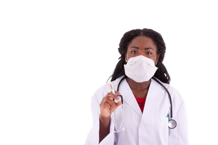 diagnostic findings: A young black woman doctor with an injection in her hand Stock Photo