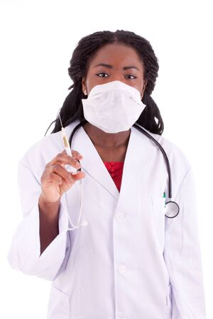 A young black woman doctor with an injection in her hand Stock Photo - 9409053