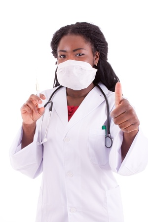 A young black woman doctor with an injection in her hand Stock Photo
