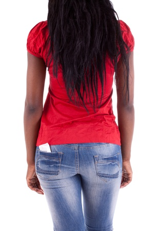 A young woman with a condom in her trouser pocket photo