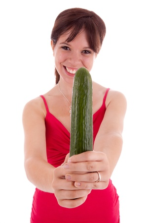 The pretty young woman holding a cucumber in his hand