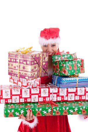 Santa Claus is holding lots of gifts in her hand photo