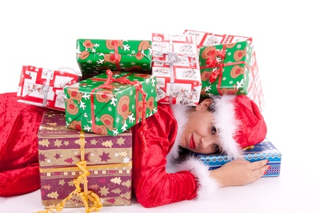 Santa Claus is lying on the floor and buried with gifts photo