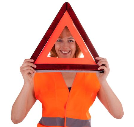 The beautiful young girl with a warning triangle photo