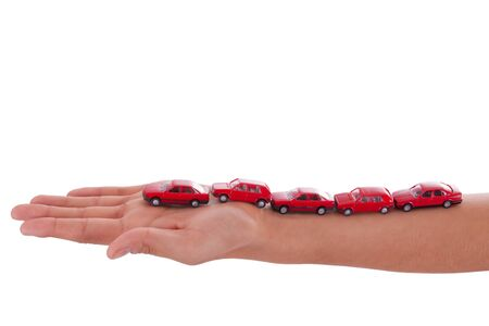 The beautiful young girl has little red cars on her arm photo