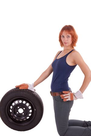 The beautiful young girl with a big tire photo