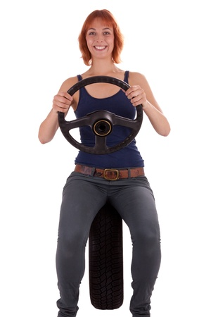 The young girl has a wheel in her hands photo