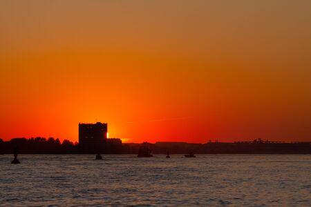 A beautiful sunset over the Elbe of Hamburg photo