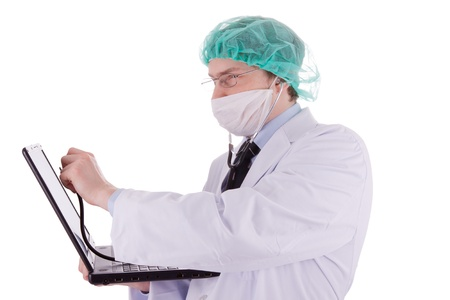 The young doctor is examining a laptop