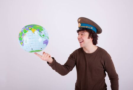 globe  the terrestrial ball: The young man is playing with a globe Stock Photo