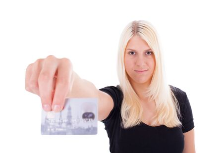 hold ups: A young woman is holding a credit card in her hand Stock Photo