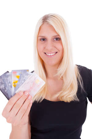 A young woman is holding credit cards in her hand photo