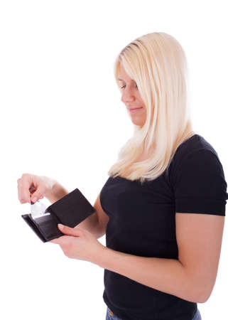 A young woman is pulling a credit card out of her purse Stock Photo