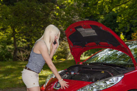 A young girl got a breakdown with her car photo