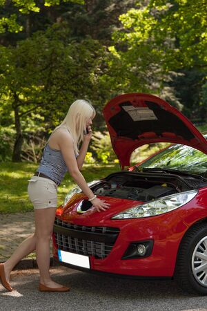 A young girl got a breakdown with her car Stock Photo - 13822669