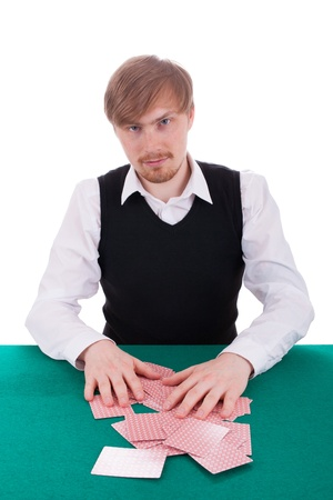 The young man is shuffling cards on the table Stock Photo - 14019788
