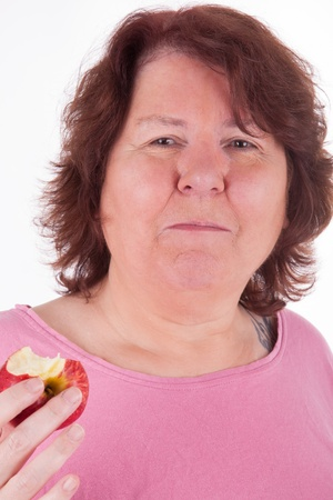 A fat woman with an apple in her hand photo