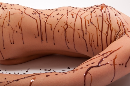Line of chocolate on naked skin