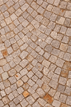 flagging: A driveway was paved with little grey road stones