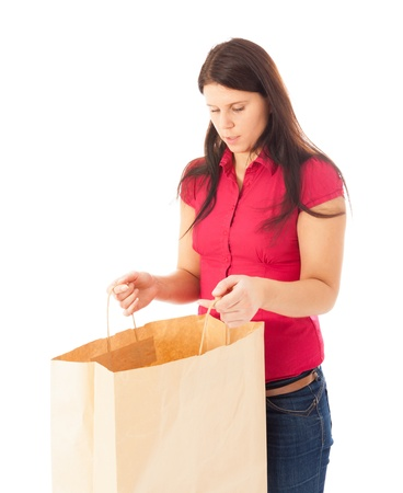 The young girl is looking into a shopping bag Stock Photo - 15896126