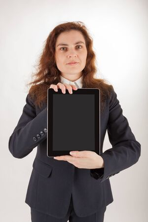 A young woman holds her tablet computer in the camera Stock Photo - 17544297