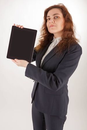A young woman holds her tablet computer in the camera Stock Photo - 17544300