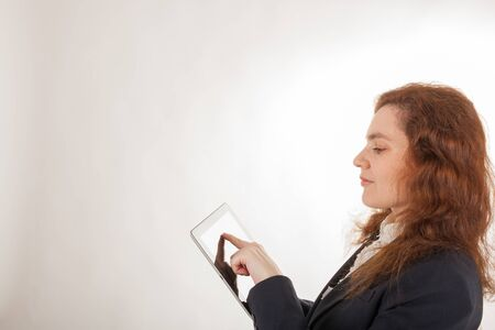 A young woman is working with her Tablet PC Stock Photo - 17544293