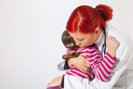 The young pediatrician comforted a little girl photo